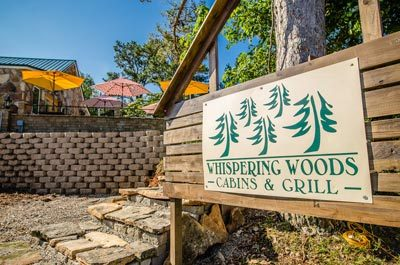 Whispering woods resort century 21 lemac realty for Whispering woods cabins