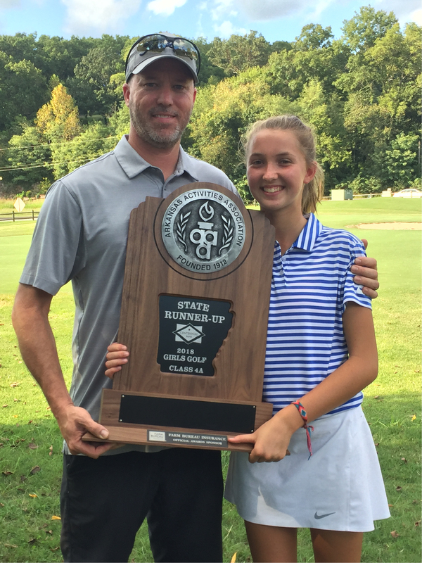 John Richardson with his youngest daughter, Riley, holding the 2018 State Runner-Up Girls Golf Class 4A trophy.