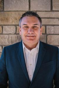 Dwayne A. Falk, CEO/President